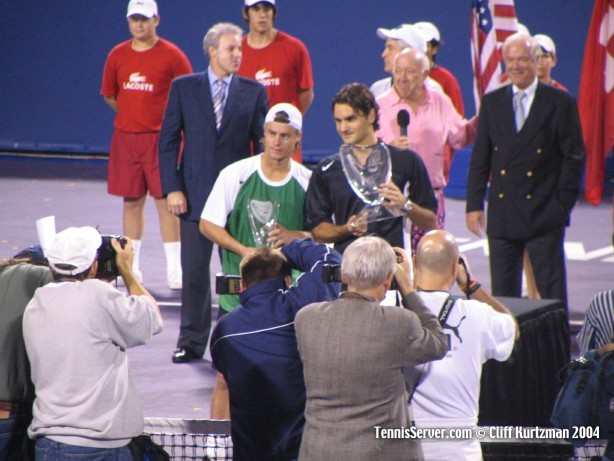 Runner-up Lleyton Hewitt (left) and Champion Roger Federer with trophies